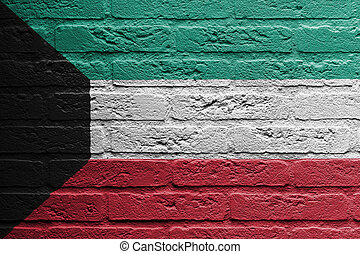 Brick wall with a painting of a flag, Kuwait - Brick wall...