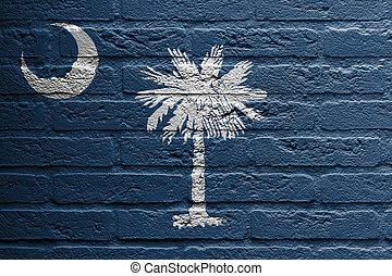 Brick wall with a painting of a flag, South Carolina - Brick...