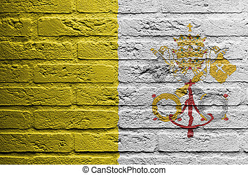 Brick wall with a painting of a flag, Vatican City