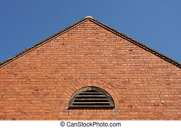 Brick wall with a pitched roof