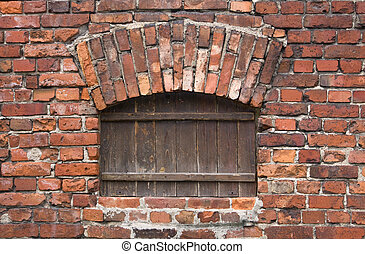 brick wall with a wooden window