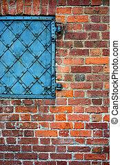 Brick wall with an old metal door