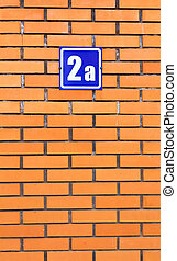 Brick wall with house number 2