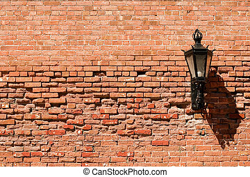 Brick wall with lamp on it.