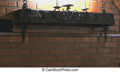 Brick wall with lamps, deer antlers, two guns