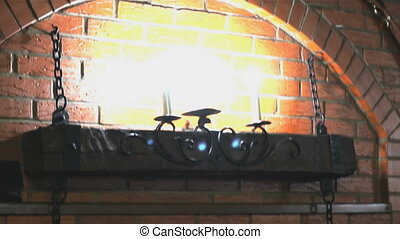 Brick wall with lamps, moose antlers, two guns