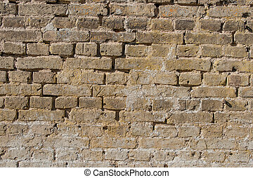 Brick wall with old stones