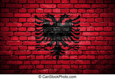 Brick wall with painted flag of Albania