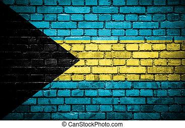Brick wall with painted flag of Bahamas