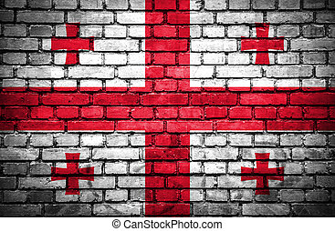 Brick wall with painted flag of Georgia