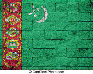 Brick wall with painted flag of Turkmenistan