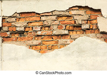 Brick wall with partially destroyed plaster, background or texture