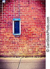 Brick wall with pay phone