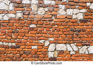 Brick wall with stones