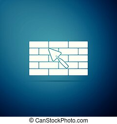 Brick wall with trowel icon isolated on blue background. Flat design. Vector Illustration