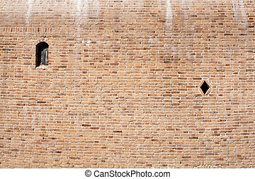 Brick wall with two small windows