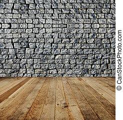 Brick wall, wood floor.