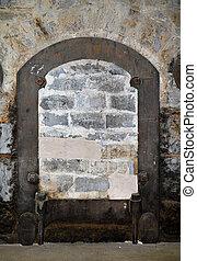 Bricked-up door in old building