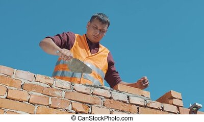 Bricklayer build walls in accordance with construction...