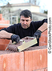 Bricklayer building a house