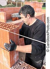 Bricklayer building wall