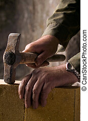 bricklayer builds the brick wall