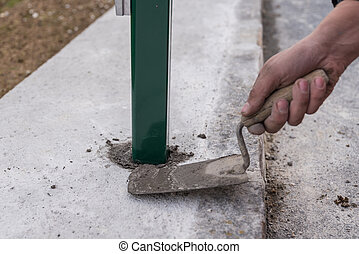 Bricklayer concreted with trowel
