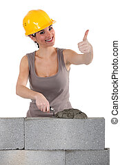 Bricklayer giving the thumb's up