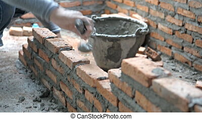 Bricklayer mortar to build the wall