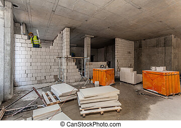 Bricklayer on the building site - Interior of a building ...