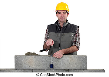 Bricklayer with a plumb line