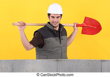 Bricklayer with spade