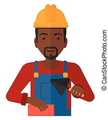 Bricklayer with spatula and brick. - A smiling...