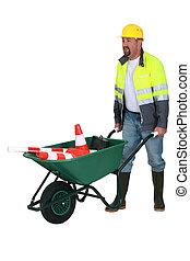 bricklayer with wheelbarrow
