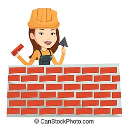 Bricklayer working with spatula and brick. - Bricklayer in...