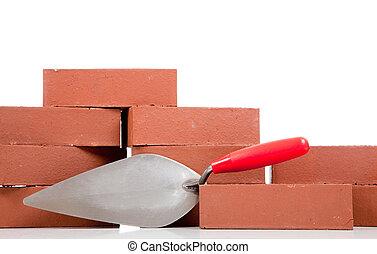 Bricks and a mason\'s trowel