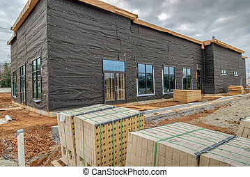 Bricks and Siding On New Commercial Building Project