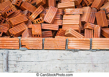 bricks with wet layer concrete in construction site, vignette