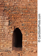 brickyard kiln entrance - an arched entrance to a brickyard...
