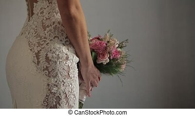 bridal Beautiful bouquet in hands of bride ,white wedding dress