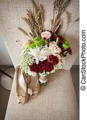 Bridal bouquet and bride shoes