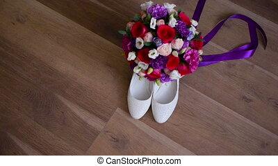 bridal bouquet and bride's shoes