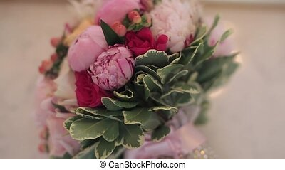 Bridal bouquet and earrings indoors