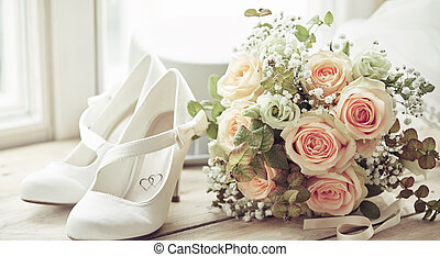 Bridal bouquet and pair of white shoes