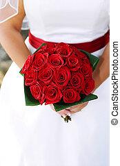 Bridal bouquet - Detail shot of bride holding her rose...