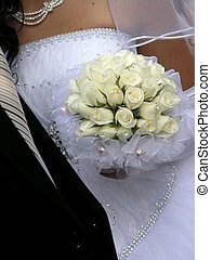 bridal bouquet - hands of just married couple holding...
