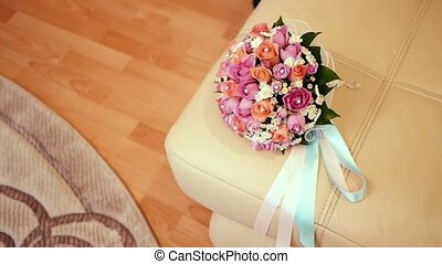 Bridal bouquet in an interior room.Wedding bouquet in a vase on the floor.Wedding interior