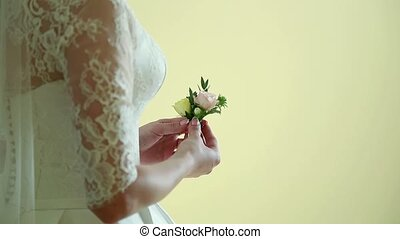 bridal bouquet in hands of bride in white wedding dress