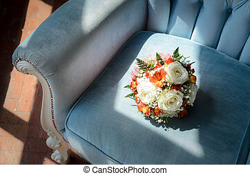 Bridal bouquet in soft antique chair