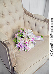 Bridal bouquet lying on the chair